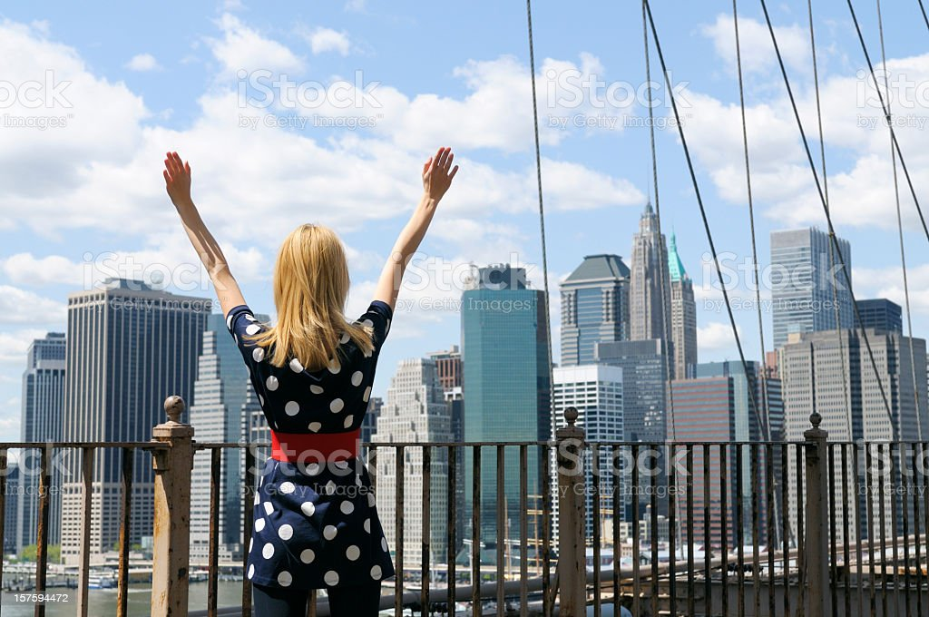 Young Woman Celebrating Success in Front of NYC Skyline royalty-free stock photo