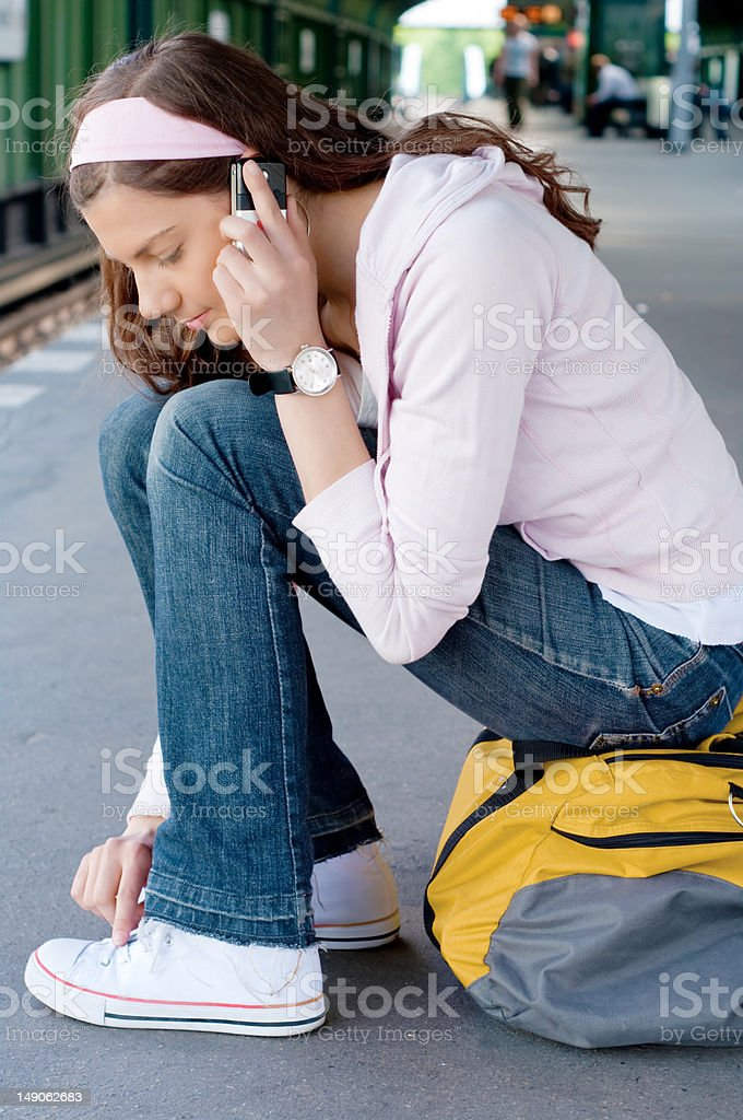 Young woman, cell phone, station stock photo