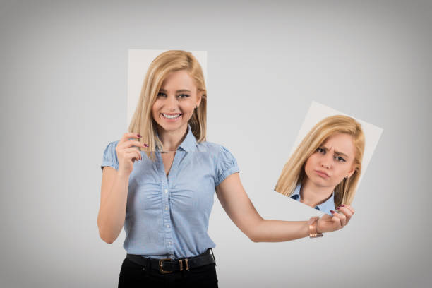 young woman changing mood from being happy to getting upset and angry - frowning stock photos and pictures
