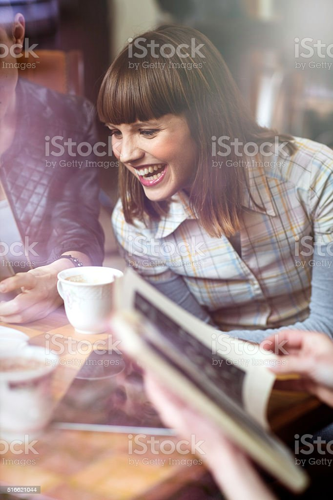 Young Woman Chatting in a Coffee Shop stock photo
