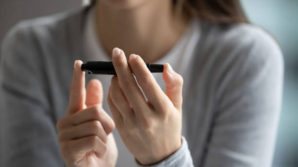 Young woman check sugar level using glucose meter Close up of unhealthy young woman hold glucose meter check sugar level pinch finger, diabetic female patient test morning insulin using glucometer lancet medical device, health problem concept lancet arch stock pictures, royalty-free photos & images