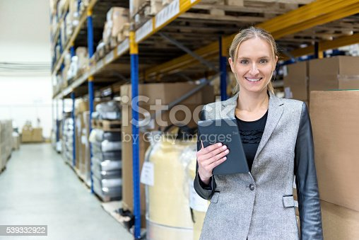915900234istockphoto Young woman checking her deliveries in warehouse 539332922