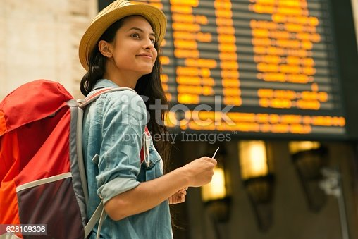 istock Young woman checking her train in time board 628109306