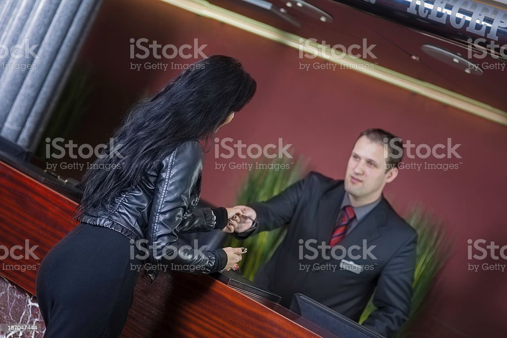 Young woman checking in to a hotel royalty-free stock photo