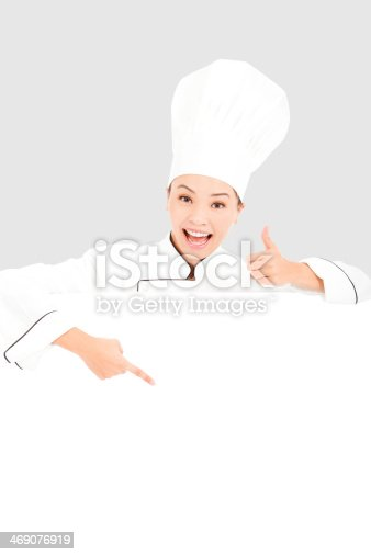 istock young woman chef smiling and thumb up   with blank board 469076919