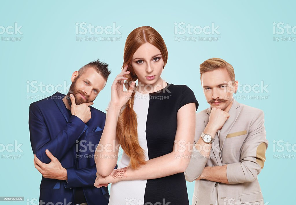 Young woman choose from two men, isolated royalty-free stock photo