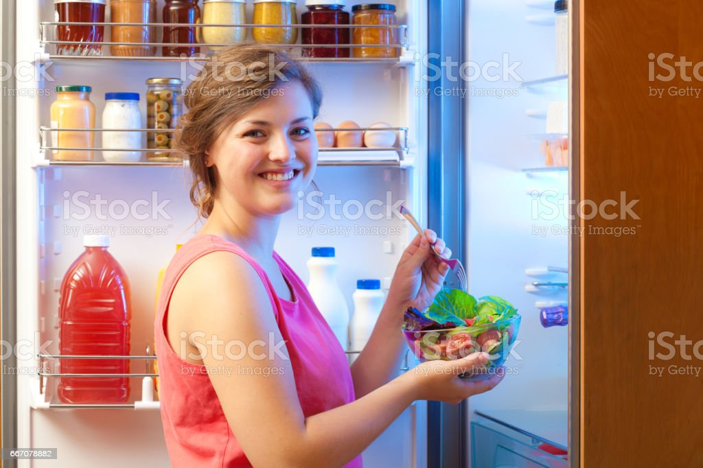 Young Woman Choosing a Healthy Salad for Healthy Eating Habbit stock photo