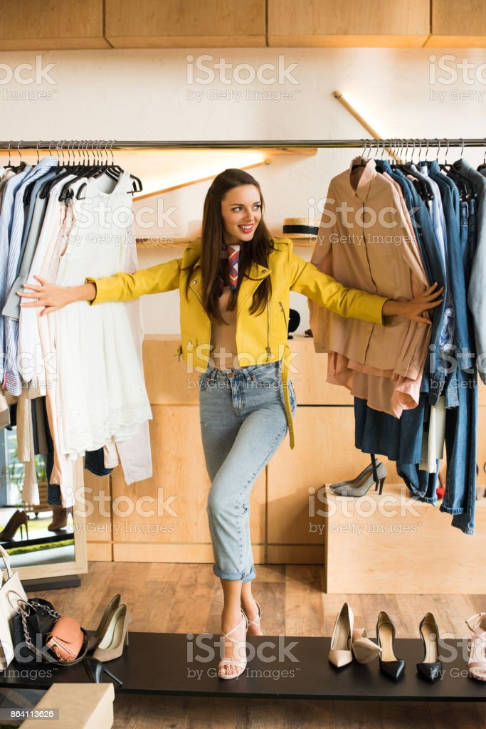 young woman choosing clothes in boutique royalty-free stock photo