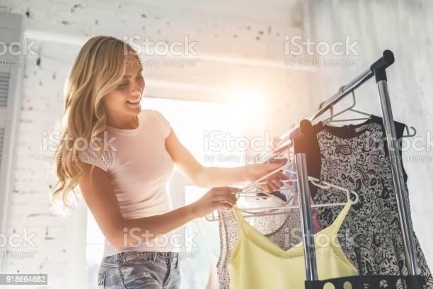 Young woman choosing clothes picture id918664682?b=1&k=6&m=918664682&s=612x612&h=ykj5dhypknkjejmspxi8urzqkiepar6ejx r5ec0jbo=
