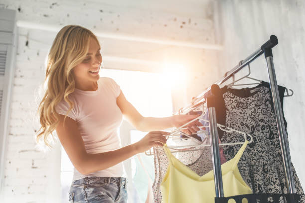 Young woman choosing clothes stock photo