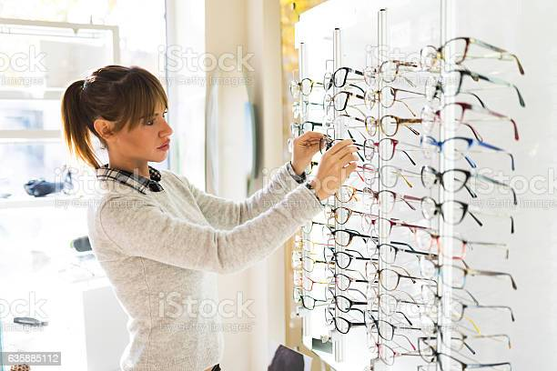 Young woman choosing glasses in optical shop picture id635885112?b=1&k=6&m=635885112&s=612x612&h=3y8ggogz5mujuotxztpirwrszoidp89m n3vwyzwrb4=
