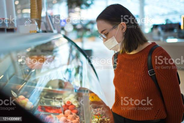 Young woman choosing icecream and wearing protective medical mask picture id1214335691?b=1&k=6&m=1214335691&s=612x612&h=5jutd4wp7s7ba3knwl1z4xteeook7i7juw7igyym0qy=