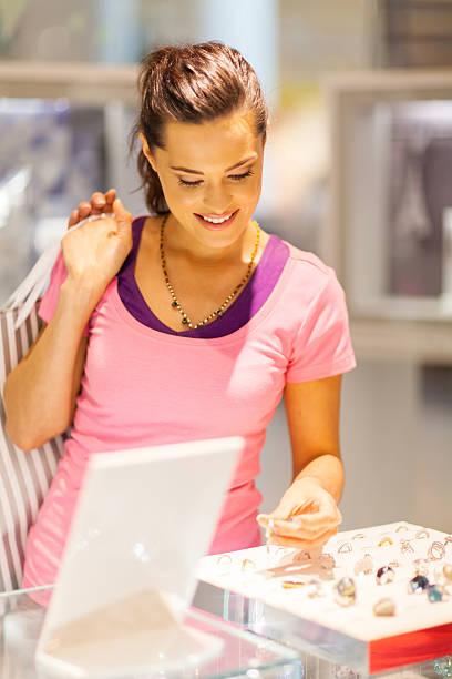 young woman choosing jewelery stock photo