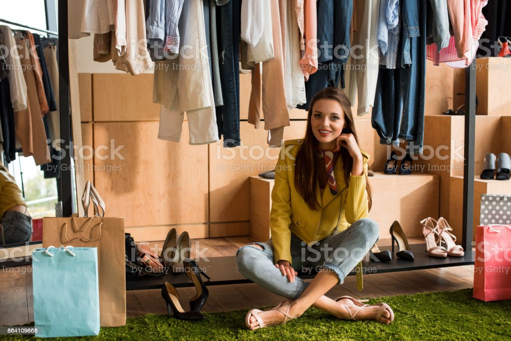 young woman choosing shoes royalty-free stock photo