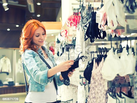 istock Young woman choosing underwear at clothing store 680671726