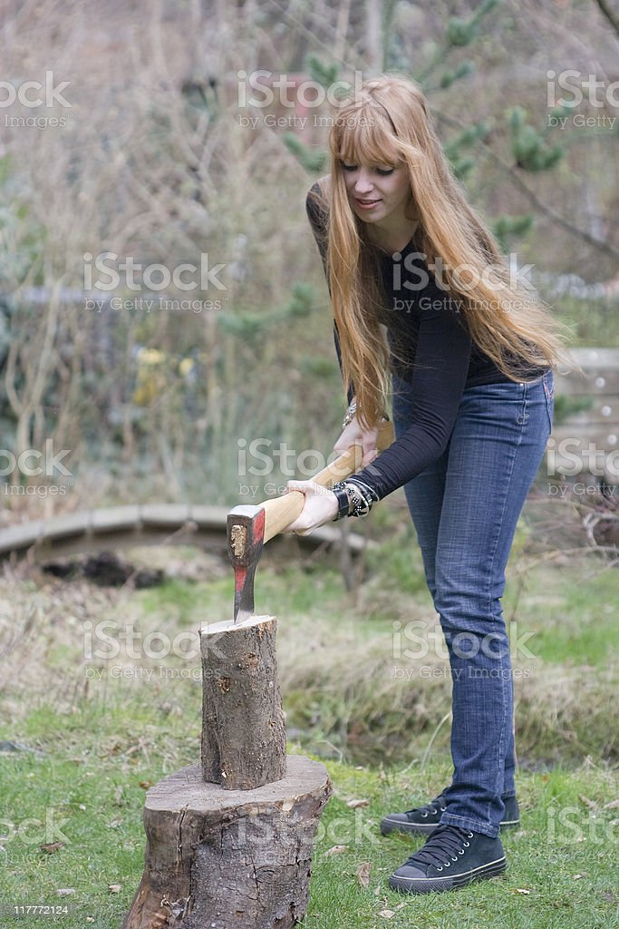 Young Woman chopping Firewood royalty-free stock photo