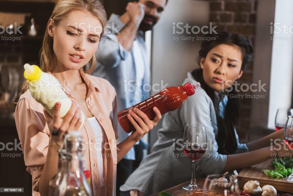 Young woman chosing sauce stock photo