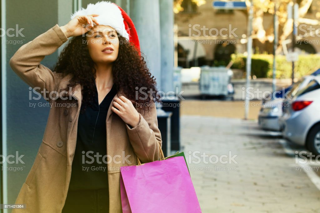 Young woman Christmas shopping stock photo