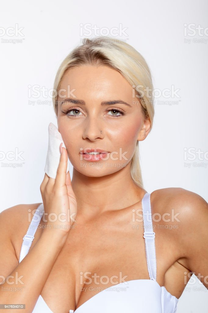 Young Woman Clean Face With Wet Wipes Stock Photo   More Pictures of ... f7f974465