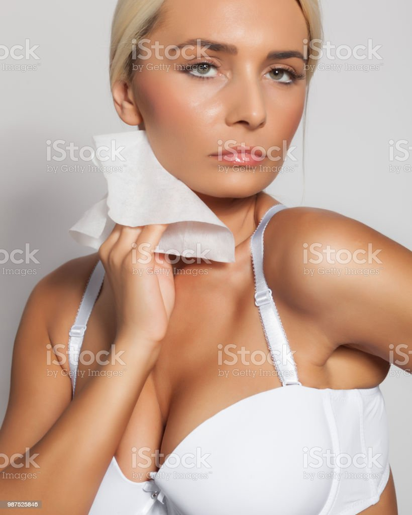 Young Woman Clean Neck With Wet Wipes Stock Photo   More Pictures of ... 692d88000