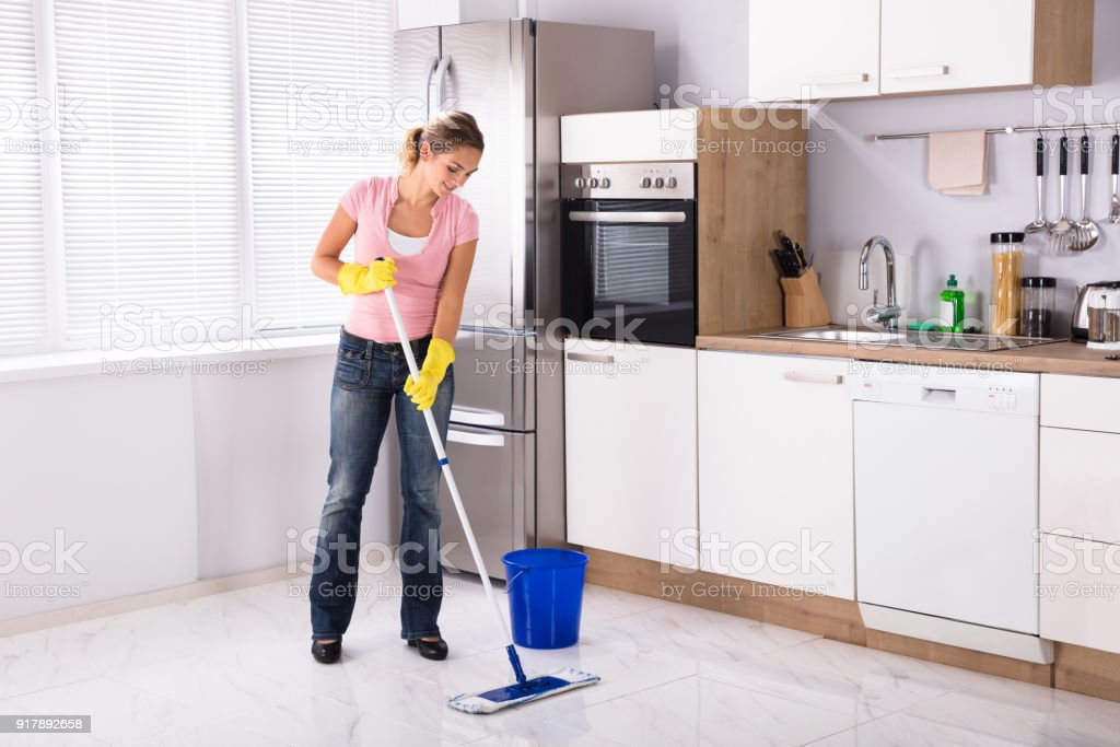Young Woman Cleaning Kitchen Floor With Mop Stock Photo & More ...