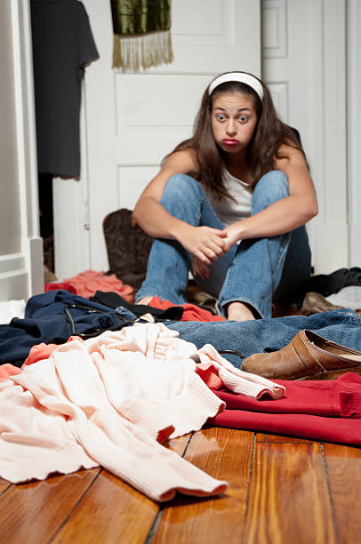 young woman cleaning out her closet - kellyjhall stock pictures, royalty-free photos & images
