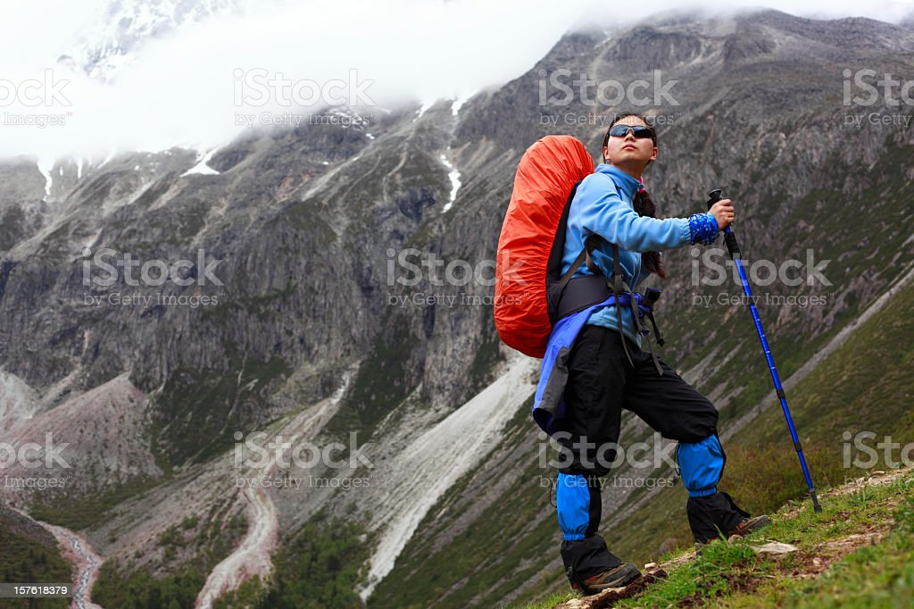 young woman climbing mountain royalty-free stock photo