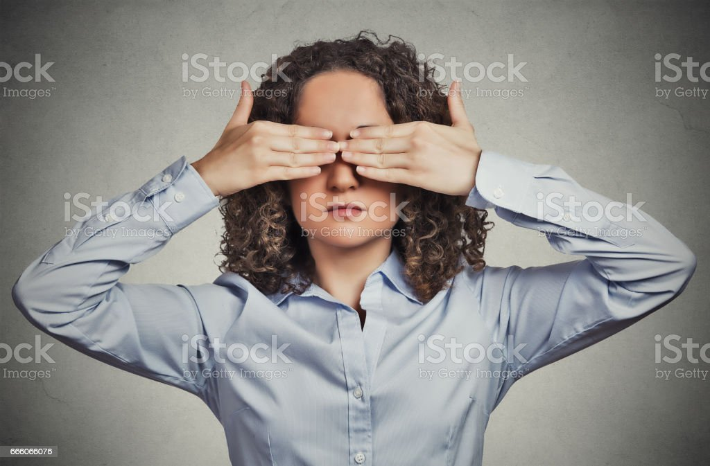 young woman closing covering eyes with hands stock photo