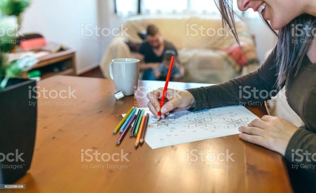 Young woman coloring mandalas stock photo