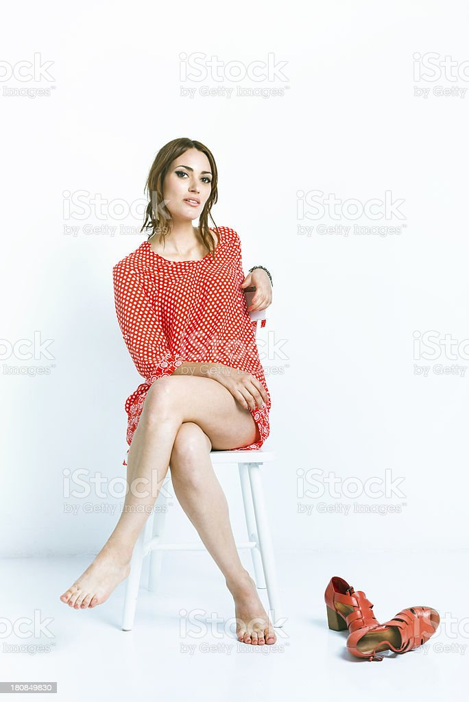 Young woman, comfortable in a white space royalty-free stock photo