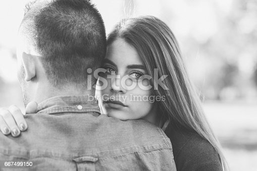 istock Young woman comforting unhappy friend 667499150