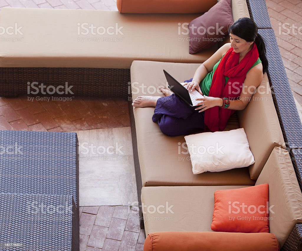 Young woman communicating via her laptop royalty-free stock photo