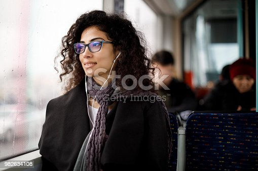 Young woman commuting by public transport