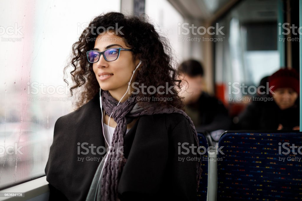 Young woman commuting by public transport stock photo