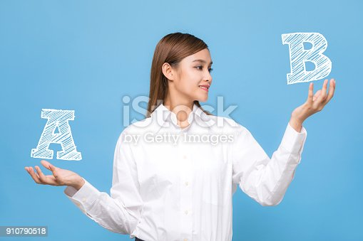 istock Young woman comparing A with B. 910790518