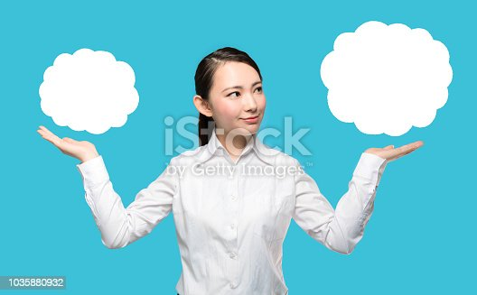 istock Young woman comparing two things. 1035880932