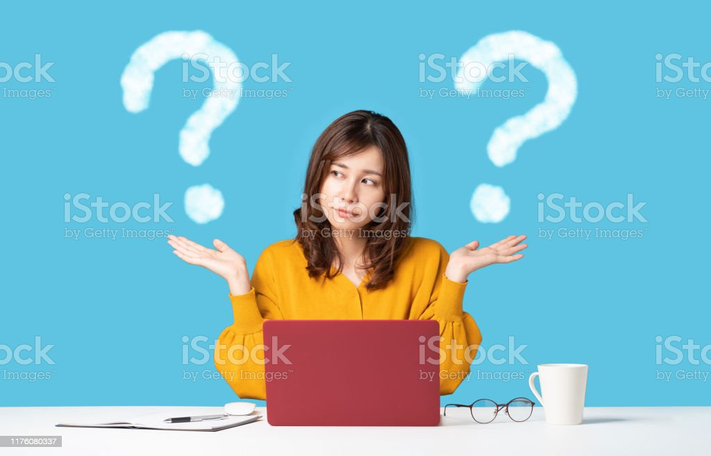 Young woman comparing with two things. Young woman comparing with two things. Adult Stock Photo