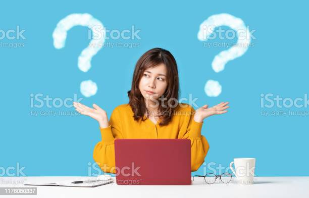 Young Woman Comparing With Two Things Stock Photo - Download Image Now