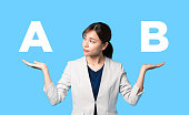 istock Young woman comparing with two things. 1218281860