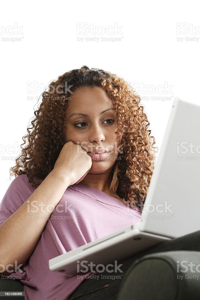 Young Woman Concentrating on a Laptop Computer at Home royalty-free stock photo
