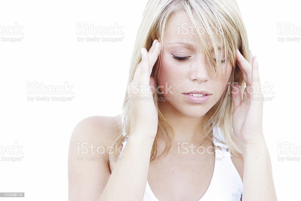Young woman concentrating with fingers to temples stock photo