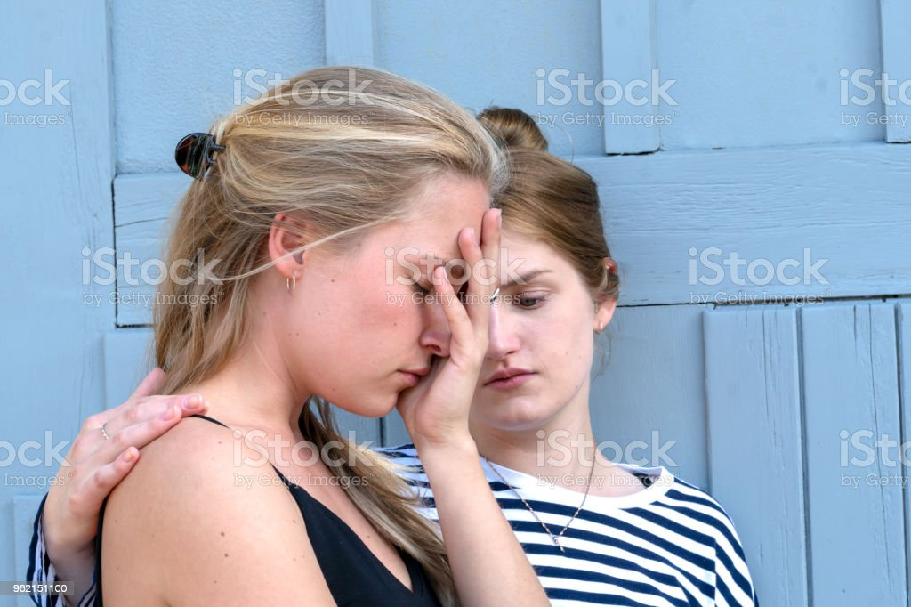 Woman consoling very sad looking friend