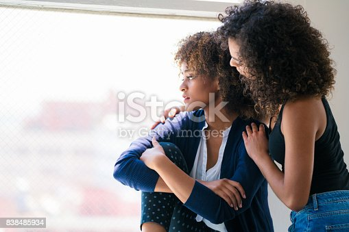 istock Young woman consoling her friend 838485934