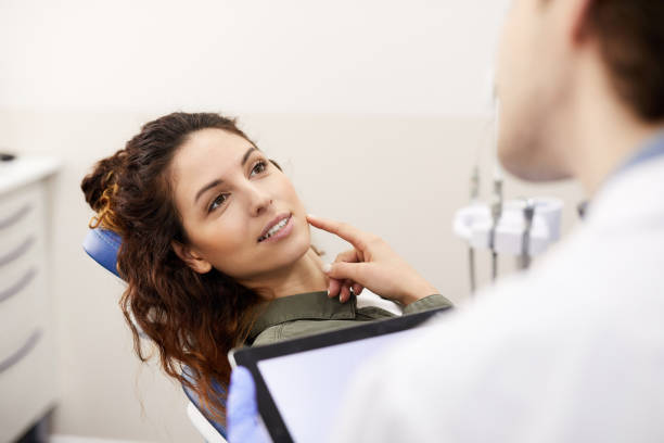 Young Woman Consulting Dentist stock photo
