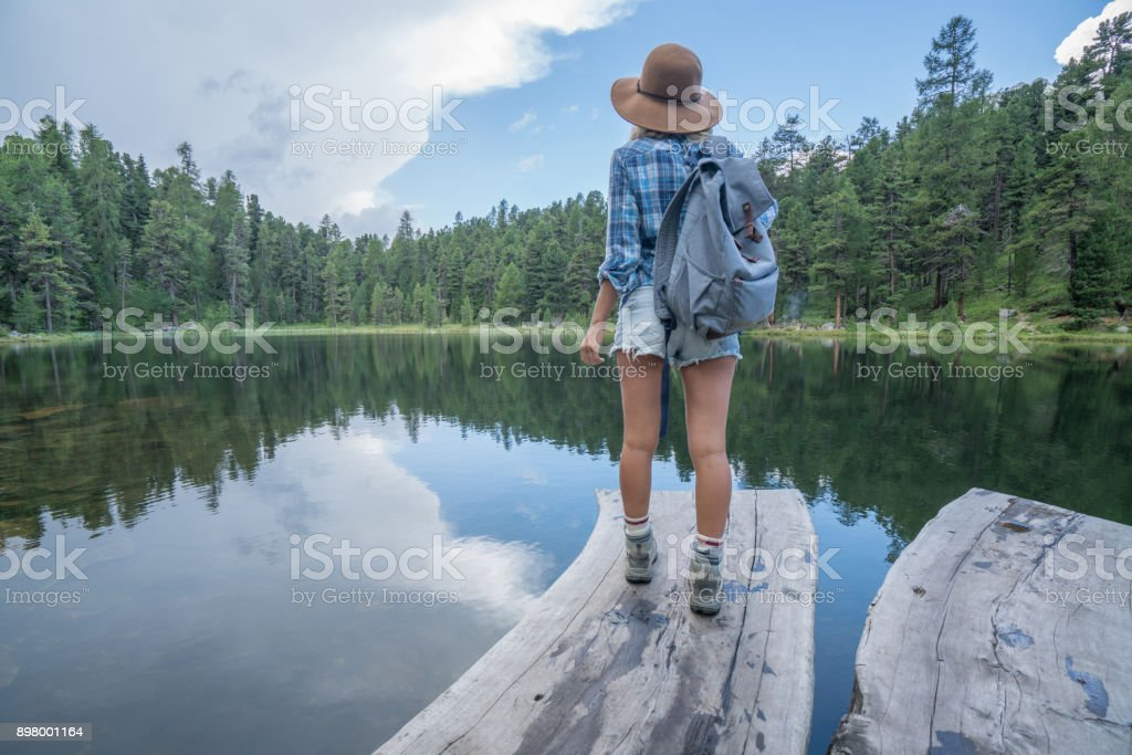 Young woman contemplating nature by the lake, Switzerland stock photo
