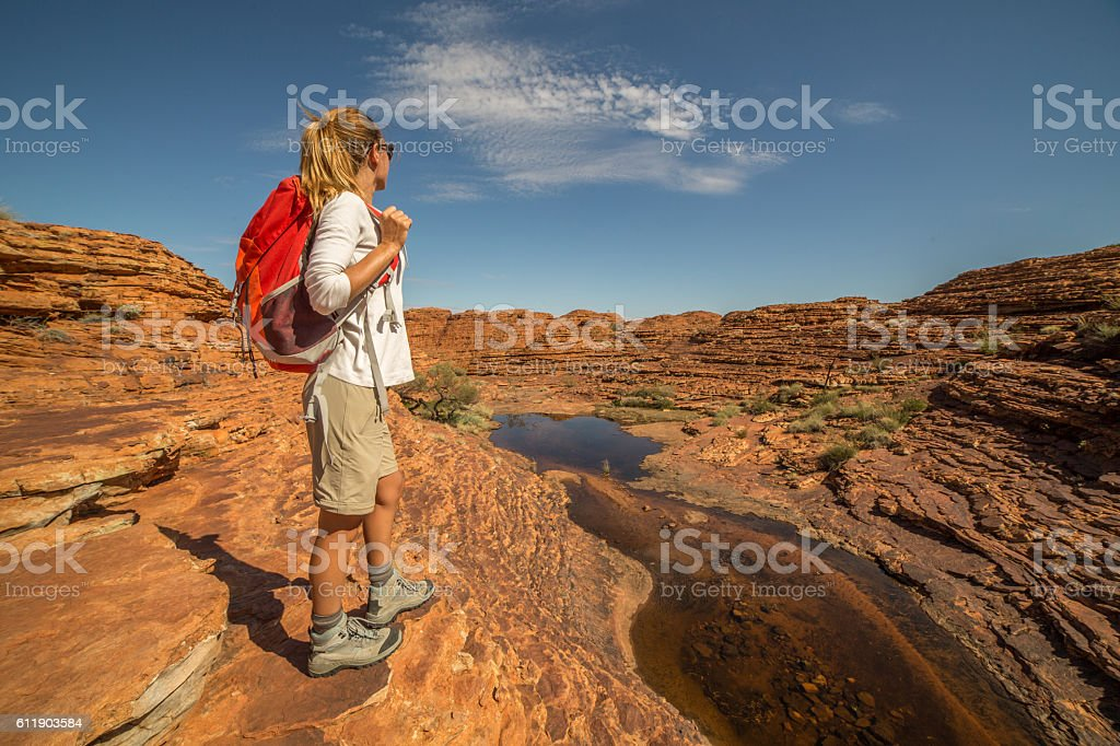 Young woman contemplating nature on hiking day stock photo