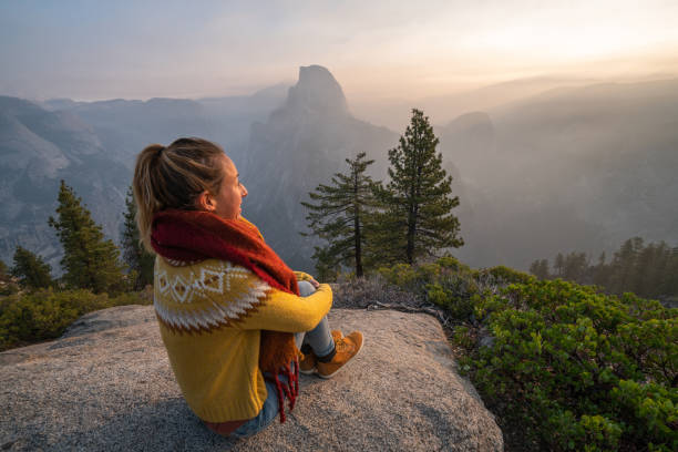Young woman contemplating view from top of Yosemite valley, USA stock photo