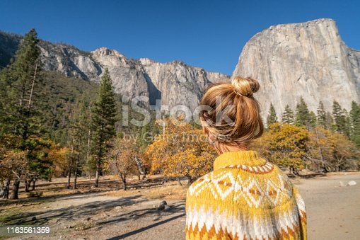 Young woman contemplating view from top of Yosemite valley, USA