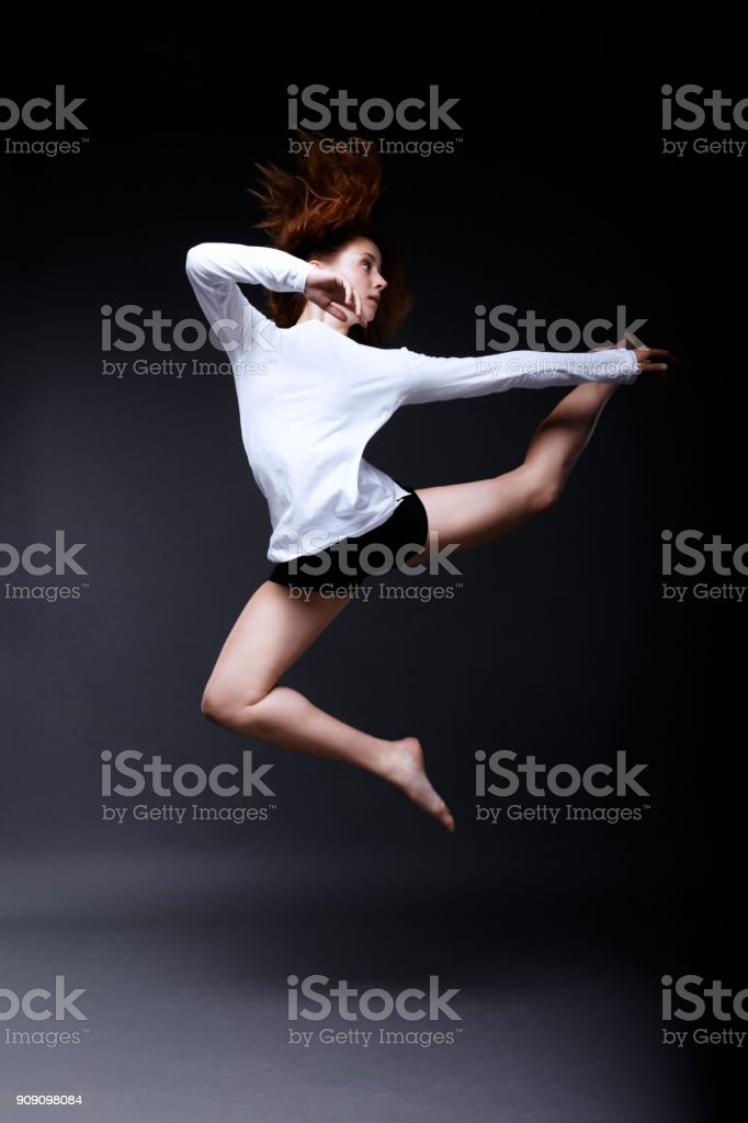 Young Woman Contemporary Dancer Posing In Dark Studio Stock Photo Download Image Now Istock
