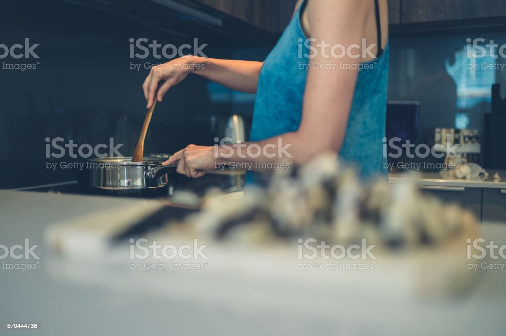 Young woman cooking in kitchen royalty-free stock photo